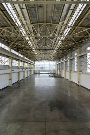 empty warehouse: Newly constructed empty warehouse factory from above during the day, filled with natural light