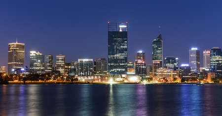 Perth, Western Australia, viewed at night reflected in the Swan River