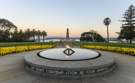 Wide angle view of the War Memorial and Eternal Flame in Kings Park, Perth, Australia at sunset