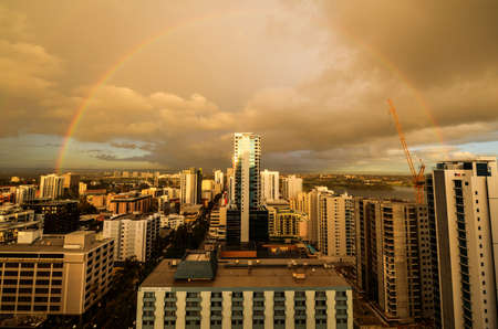 Perth, Australia Skyline at sunset looking westward with a rainbow in the distance.