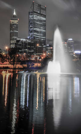Skyline of Perth, Australia. View from John Oldany park. Australian skyscrapers and lights reflected in the water. Stock Photo - 24669112