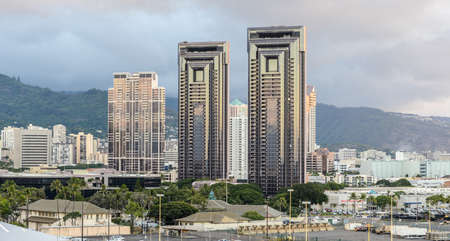 hawaii sunset: Skyline of Honolulu with residential towers against the misty hills.