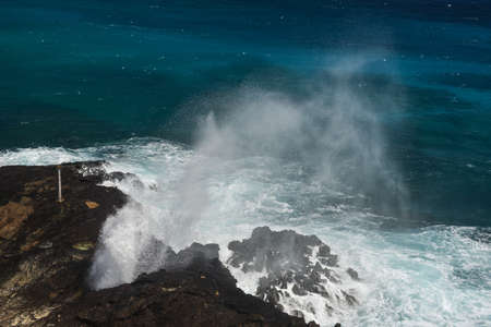 Halona Blow Hole on a clear, sunny day at Oahu, Hawaii. photo