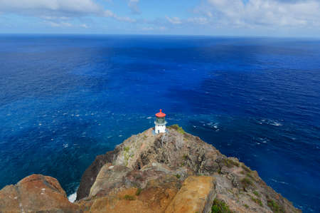 Makapuu Point lighthouse off Oahu, Hawaii, off of the coast of Oahu, Hawaii. The Makapuu Point Light on the island of Oahu has the largest lens of any lighthouse in the United States.