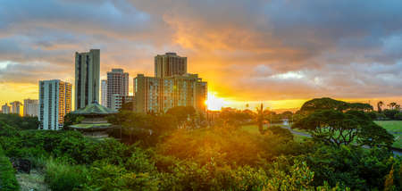 Sunset at Waikiki over the skyline in Oahu, Hawaii. photo
