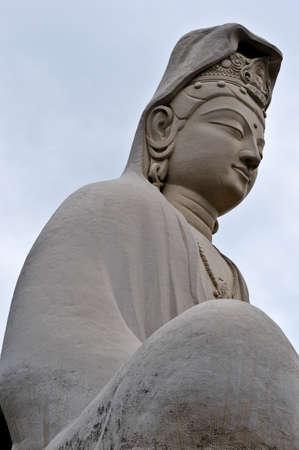 third eye: Buddha in serene meditation, main statue of the Ryozen Kannon WWII Memorial Shrine, Kyoto, Japan.  As seen up close. Stock Photo