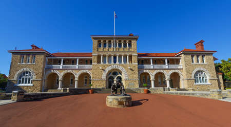 Perth Mint building, one of three branches as part of the Royal Australian Mint  Limestone building built in 1899  Facade with a statue of prospectors striking gold
