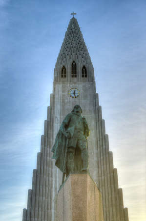 leif: Hallgrimskirkja Cathedral in Reykjavik, Iceland with Leif Eriksson Monument.  The Lutheran (Church of Iceland) parish church in Reykjavík, Iceland. At 73 metres (244 ft), it is the largest church in Iceland. Stock Photo