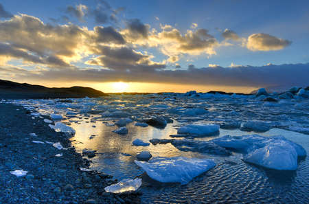 View of the glacier lagoon, Jokulsarlon, Iceland at sunset. Jokulsarlon is a large glacial lake in southeast Iceland, on the edge of Vatnajokull National Park.