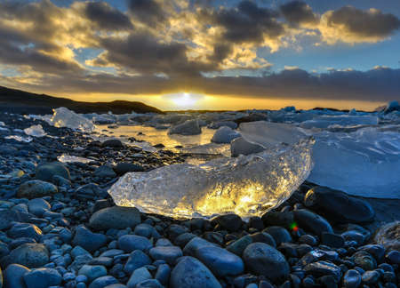 View of the glacier lagoon, Jokulsarlon, Iceland at sunset. Jokulsarlon is a large glacial lake in southeast Iceland, on the edge of Vatnajokull National Park. photo