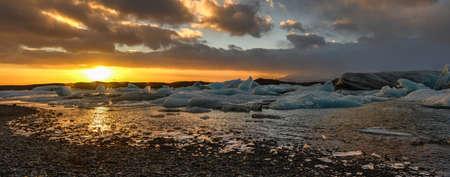 View of the glacier lagoon, Jokulsarlon, Iceland at sunset. Jokulsarlon is a large glacial lake in southeast Iceland, on the edge of Vatnajokull National Park.