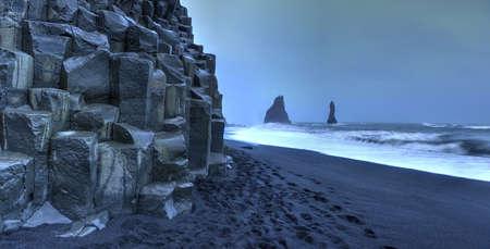 Panoramic view of Reynisdrangar rock formations on Reynisfjara Beach at dusk, Halsanefhellir, Iceland  photo