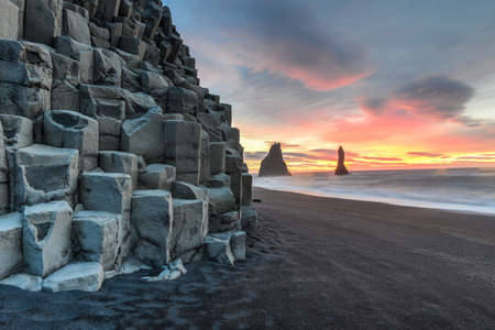 Wide view of Reynisdrangar rock formations on Reynisfjara Beach at sunrise, Halsanefhellir, Iceland  photo