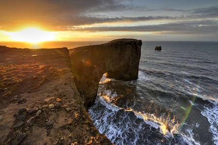 rock arch: Dyrholaey sea rock arch, Iceland at dawn  Stock Photo