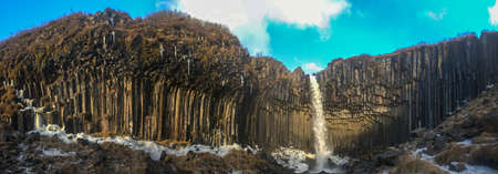 Panorama of Svartifoss Waterfall in Early Winter  Svartifoss  Black Fall  is a waterfall in Skaftafell in Vatnajokull National Park in Iceland, and is one of the most popular sights in the park  photo