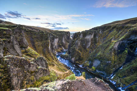 Fjadrargljufur canyon in southeast Iceland which is up to 100m deep and about 2 km long, with the Fjadra river flowing through it  It is near the Ring Road, by the village of Kirkjubaejarklaustur