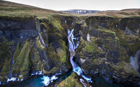 Fjadrargljufur canyon in southeast Iceland which is up to 100m deep and about 2 km long, with the Fjadra river flowing through it  It is near the Ring Road, by the village of Kirkjubaejarklaustur  photo