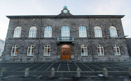 The National Parliament Building in Reykjavik, Iceland in early winter  photo