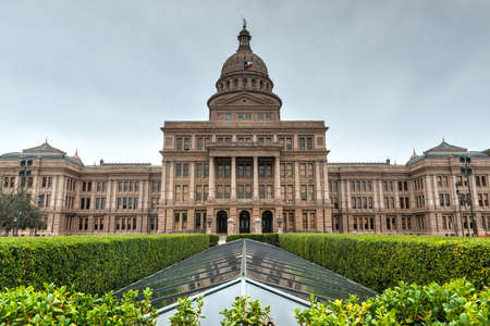 The Texas State Capitol Building with a view of the modern extension in downtown Austin. The building was built in 1882-1888 of distinctive sunset red granite. photo