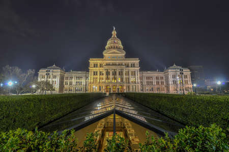 The Texas State Capitol Building with a view of the modern extension in downtown Austin at Night. The building was built in 1882-1888 of distinctive sunset red granite. photo