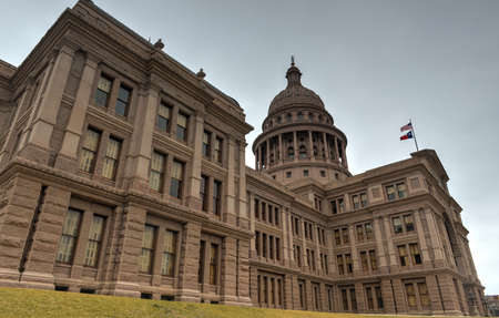 The Texas State Capitol Building in downtown Austin. The building was built in 1882-1888 of distinctive sunset red granite.