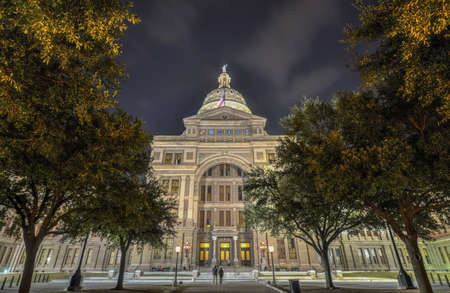 distinctive: The Texas State Capitol Building in downtown Austin at Night. Built in 1882-1888 of distinctive sunset red granite. Stock Photo