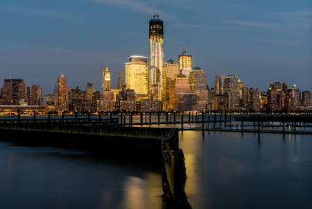 Lower Manhattan from New Jersey across the Hudson River docks at sunset. photo