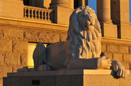 governor: Lion of the State Capitol Building in Salt Lake City, Utah at sunset. The building houses the chambers of the Utah State Legislature, the offices of the Governor and Lieutenant Governor of Utah. Stock Photo