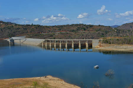 The Maguga Dam is a dam on the Komati River in Hhohho, Swaziland. It is 115 metres high and is located 11 kilometres south of Piggs Peak.