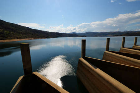 View from the Maguga Dam. Maguga Dam is a dam on the Komati River in Hhohho, Swaziland. It is 115 metres high and is located 11 kilometres south of Piggs Peak. Banco de Imagens