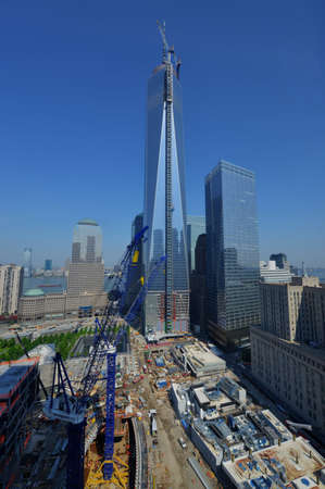 NEW YORK - MAY 30, 2013: Aerial view looking East at 1 World Trade Center under construction with the newly attached spire and with 7 World Trade Center next door.