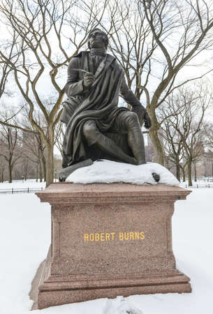 Monument to Scottish Poet Robert Burns in Central Park, New York in the winter.