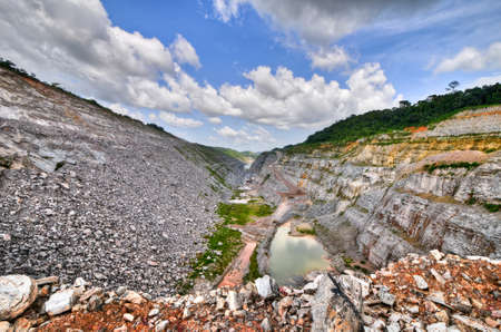mining: Open Pit Gold Mine in Ghana, Africa with a view of the cut out earth.