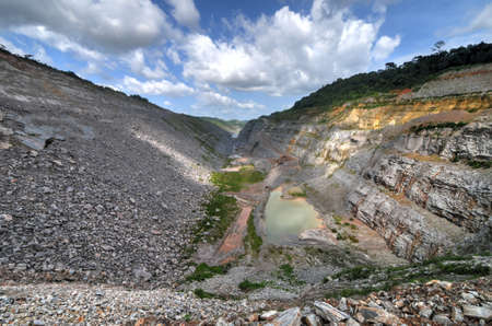 Open Pit Gold Mine in Ghana, Africa with a view of the cut out earth. photo