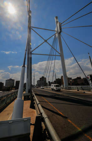 Nelson Mandela Bridge, daytime. The 284 metre long Nelson Mandela Bridge, officially opened by Nelson Mandela himself, which crosses over the 40 railway lines that lie spread beneath its span.