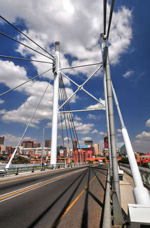 johannesburg: Nelson Mandela Bridge, daytime. The 284 metre long Nelson Mandela Bridge, officially opened by Nelson Mandela himself, which crosses over the 40 railway lines that lie spread beneath its span.