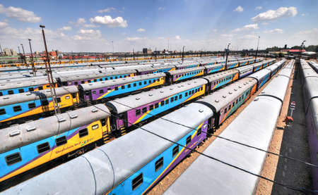 The Braamfontein Railway Yards with their colorful cars under the Nelson Mandela Bridge. The yards lie between Newtown and Braamfontein in Johannesburg, South Africa.