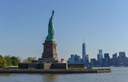 city view: View of the Statue of Liberty and the New York City Skyline.