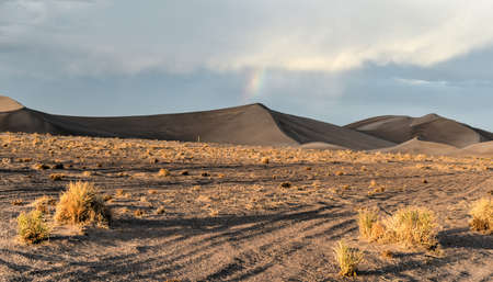 nevada: Sand Dunes and rainbows along the Amargosa Desert at sunset. Located in Nye County in western Nevada, United States, along the California-Nevada border Stock Photo