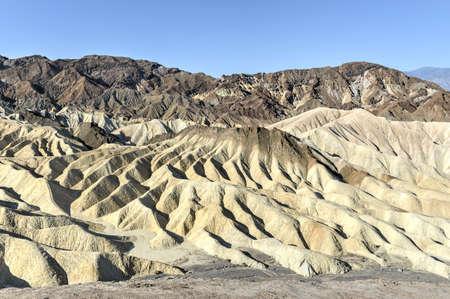 Eroded Mountain Ridges at Zabriskie Point in Death Valley National Park, California, USA. Zabriskie Point is a part of Amargosa Range located east of Death Valley in Death Valley National Park. photo