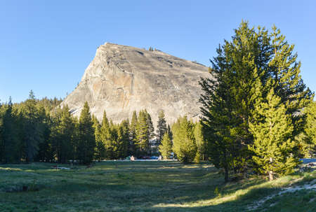 dome rock: View of Lembert Dome, a granite dome rock formation in Yosemite National Park in the U.S. state of California. The dome soars 800 feet above Tuolumne Meadows and the Tuolumne River.