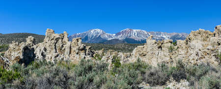 sierra snow: Tufa Formation in Mono Lake Tufa State Natural Reserve, California with snow covered Sierra Mountains in the background.