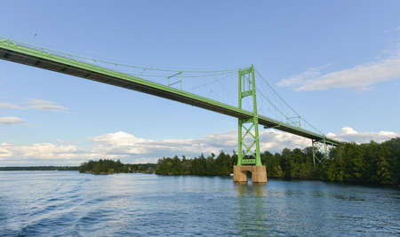 The Thousand Islands Bridge. An international bridge system constructed in 1937 over the Saint Lawrence River connecting northern New York in the United States with southeastern Ontario in Canada. photo