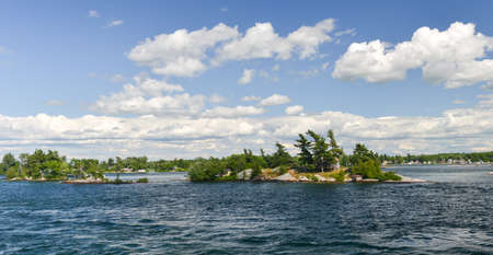 House on a windswept island of the Thousand Islands on the Saint Lawrence River. photo