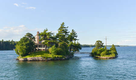 The smallest international bridge connecting two of Thousand Islands on Saint Lawrence River - one island is USA and other is Canada photo