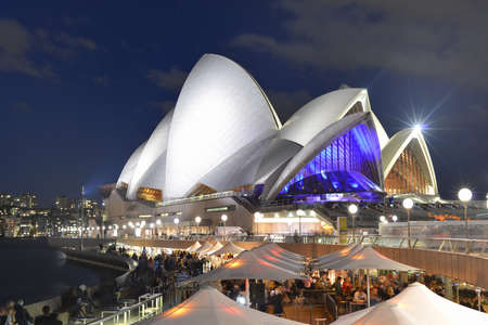 Sydney Opera House at night along with an energetic night scene.