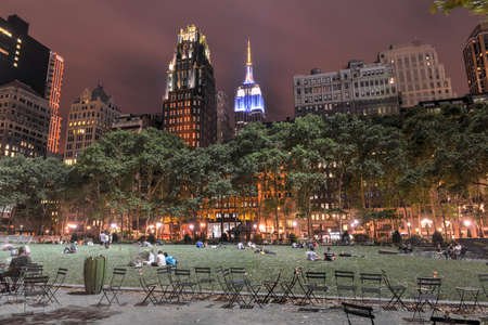 bryant: View of Bryant Park and Manhattan Skyscrapers at Night.