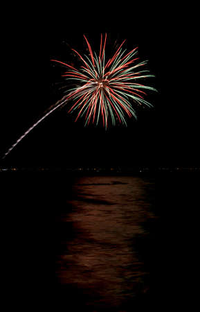 coney: Coney Island Fireworks on the beach on a summer evening reflecting in the Atlantic Ocean. Stock Photo