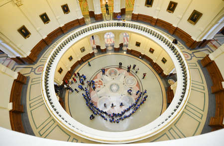 visitors area: AUSTIN, TEXAS - MARCH 7: Rotunda area with Governors portraits in the Texas State Capitol building with visitors on March 7, 2014 in Austin, Texas.