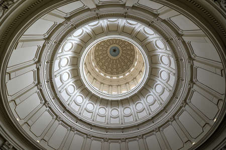 AUSTIN, TEXAS - MARCH 7: Rotunda area and dome with Governors portraits in the Texas State Capitol building on March 7, 2014 in Austin, Texas.